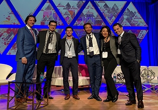 A photograph of Dr. Jason and presenters onstage at the 2018 ASAPS Meeting