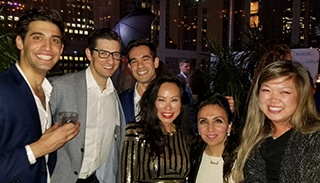 A photograph of Dr. Jason Roostaeian and Dr. Mytien Goldberg at an Aesthetic Meeting 2018 cocktail party