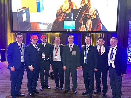 A photo of Dr. Jason Roostaeian, Dr. Rod Rohrich and colleagues onstage at the ASAPS 2019 Meeting