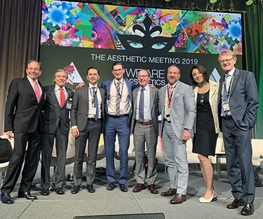 A photograph of Dr. Jason Roostaeian and collleague presenters onstage at the ASAPS 2019 Meeting
