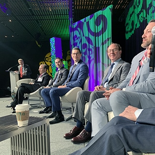 A photo of Dr. Jason Roostaeian and colleague panelists onstage at the Aesthetic Meeting ASAPS 2019