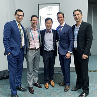 A photograph of Dr. Jason Roostaeian, Dr. Jacob Unger, Dr. Mike Newman at the American Society of Plastic Surgery Meeting 2019