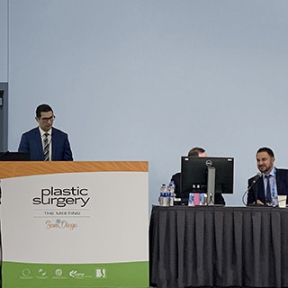 A photograph of Dr. Jason Roostaeian presenting at the American Society of Plastic Surgeons Meeting 2019