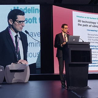 A photo of Dr. Jason Roostaeian presenting onstage at the South American Plastic Surgery meeting 2019