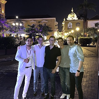 A photo of Dr. Jason Roostaeian, Dr. Humberto Morelli and colleagues at a SAPS 2019 social event