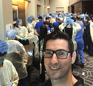 A selfie of Dr. Jason Roostaeian at the cadaver lab at the Dallas Rhinoplasty Meeting 2018