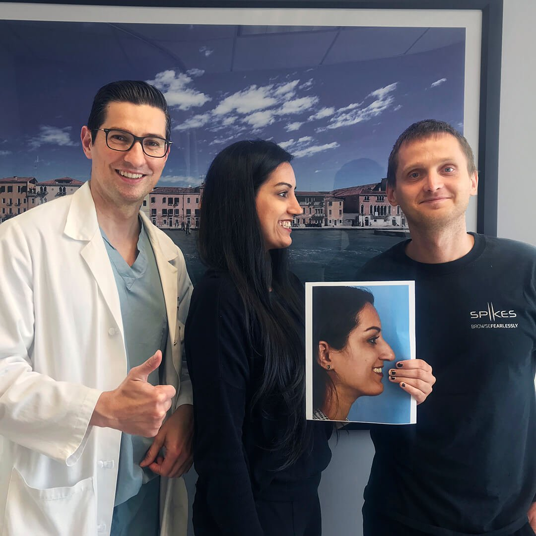 A photo of Dr. Jason Roostaeian and a natural looking rhinoplasty female patient